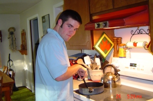 Tyler in the kitchen cooking......yeah baby!!